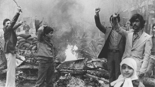 Iranians demonstrate on the eve of Islamic leader Ayatollah Ruhollah Khomeini's return.