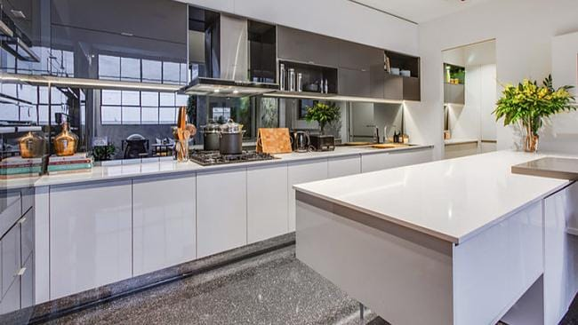 Apartment 3 — A glossy finish helps the kitchen extend the light and bright feel found throughout the apartment.