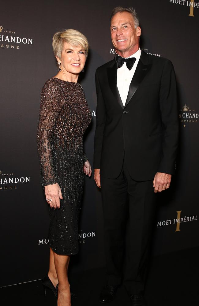 Julie Bishop, pictured with her partner David Panton, is becoming a bit of a fashion icon following her success on Budget night, stealing the show in a blue sparkly dress. Picture: Matrix Media