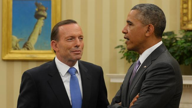 Strong allies ... Tony Abbott meets with President Obama in the Oval Office of The White House. Picture: Jake Nowakowski