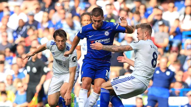 Eden Hazard of Chelsea is challenged by Joe Ralls (R) and Harry Arter of Cardiff City