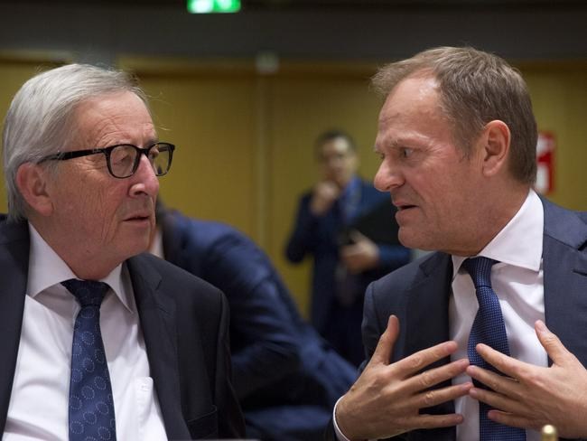 European Commission President Jean-Claude Juncker, left, speaks with European Council President Donald Tusk during a summit in Brussels. Picture: AP