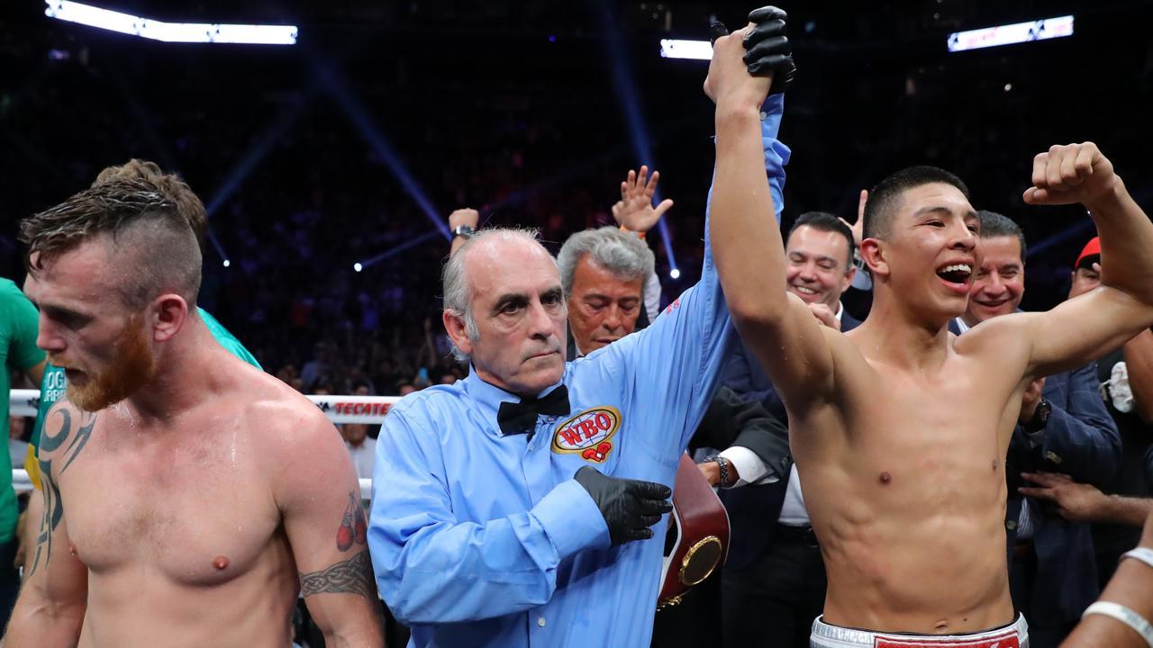 Jaime Munguia celebrates his victory over Dennis Hogan.