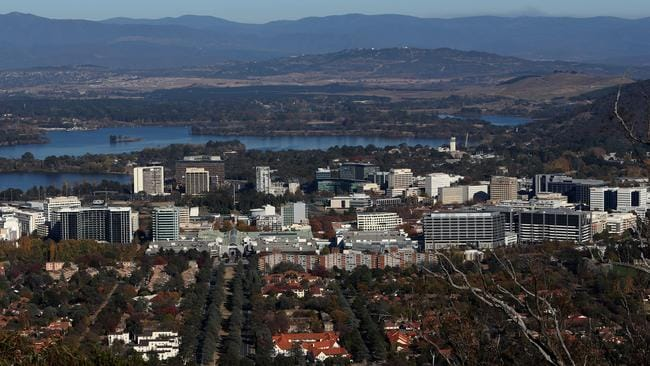 A classic view of Canberra with the comfortable suburbia in the foreground, the bland white buildings in the middle ground and a bunch of empty wasteland in the background. Paradise!