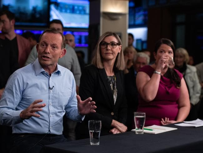 Former Prime Minister, Tony Abbott, United Australia Party candidate Suellen Wrightson (middle) and Greens candidate Kristyn Glanville speaking at the Harbord Beach Hotel.