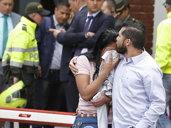 Family members of victims at the scene. Picture: AP