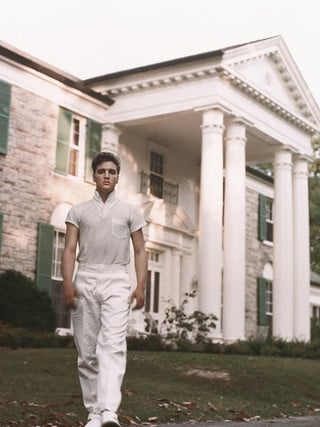Elvis Presley strolls the grounds of his Graceland estate in circa 1957. Picture: Supplied