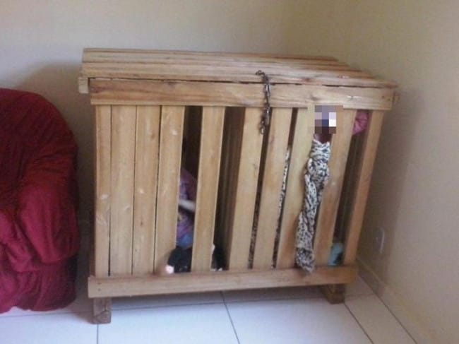 Police discovered the twin boys inside this wooden crate locked with a padlock and chain. Picture: The Sun