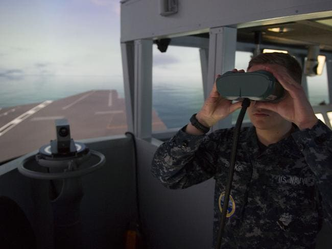 Boatswain's Mate Seaman Recruit Daniel Banks, assigned to Pre-Commissioning Unit Gerald R. Ford (CVN 78), stands as the port lookout during a simulated bridge training exercise, a monthly simulation to prepare to successfully navigate an aircraft carrier at sea. Picture: US Navy