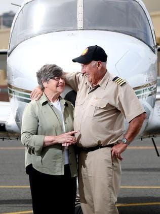 Outback adventurer Dick Lang with wife Helen and one of their planes at Parafield Airport. Picture: Calum Robertson