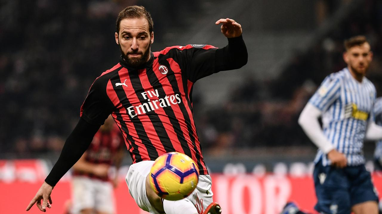 AC Milan's Argentinian striker Gonzalo Higuain controls the ball