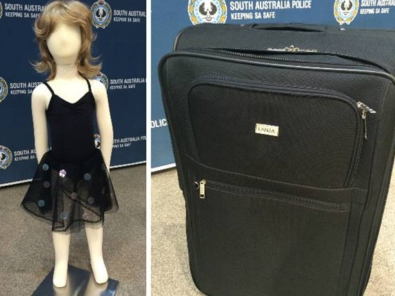 Model with clothing and suitcase on display by police before they had a breakthrough.