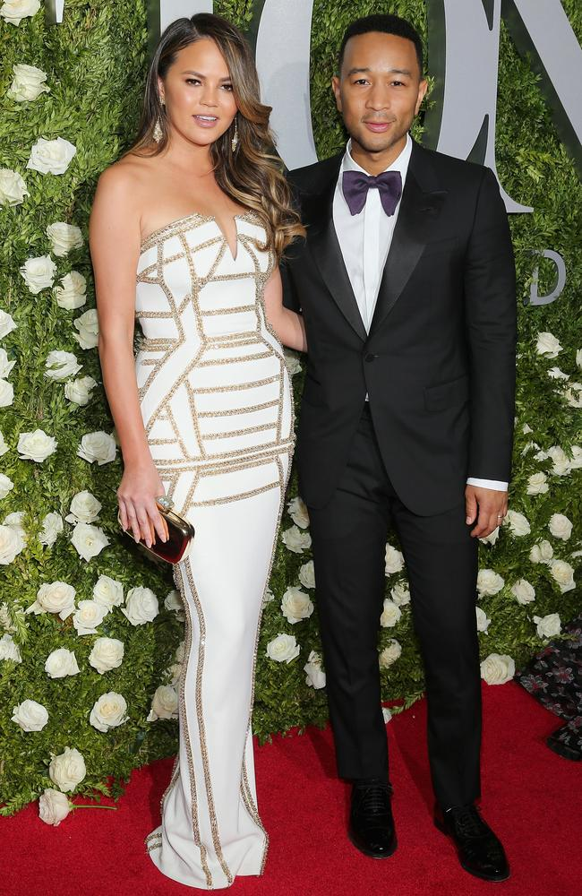 Chrissy Teigen and John Legend smoulder as they make their way into Radio City Music Hall.