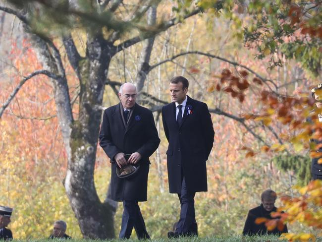 French writer Michel Bernard and French president Emmanuel Macron during the centenary of the First World War. Police have arrested six suspects who were plotting to attack Macron. Picture: AFP