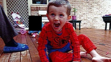 Photograph of William Tyrrell playing on the veranda the morning of his abduction in the NSW town of Kendall. Picture: NSW Coroner