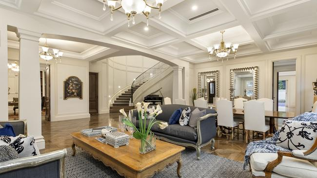 The formal living and dining room, with coffered ceilings.