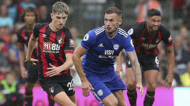 Bournemouth's David Brooks challenges Cardiff's Joe Ralls for the ball