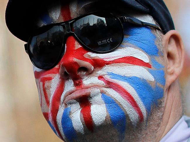 A pro-Brexit activist with his face painted in the colours of a Union flag protests near the Houses of Parliament in central London this week. Picture: Tolga Akmen/AFP