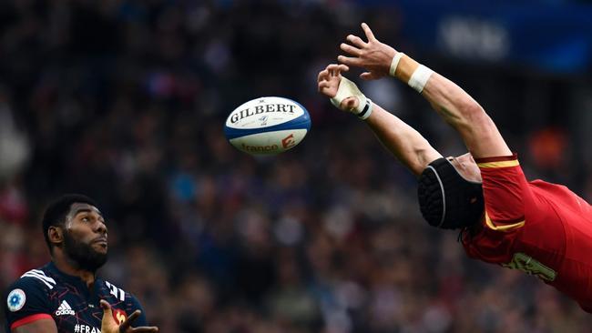 France winger Noa Nakaitaci tries to grab the ball despite Wales' Samson Lee.