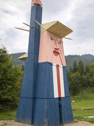 A wooden statue resembling Donald Trump has been built near Kamnik, Slovenia. Picture: AP/Darko Bandic.