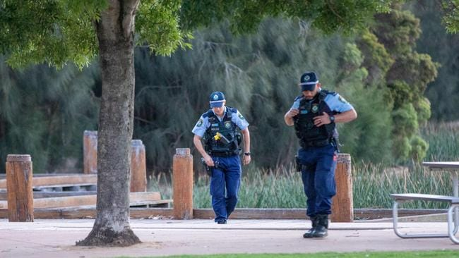 Police at Woodcroft Lake. Picture: Dean Asher
