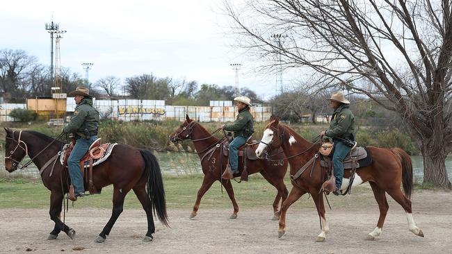 Law enforcement is also patrolling on horseback. Picture: Joe Raedle