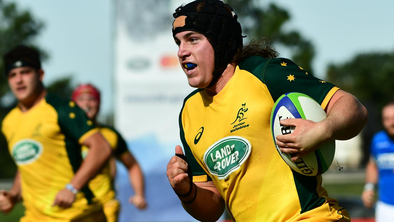 Lachlan Lonergan of Australia runs with the ball to score a try during a first-round match.