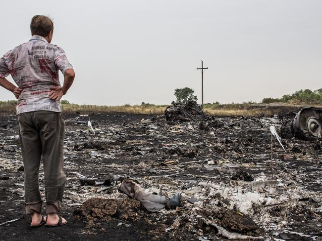 All that remains ... A man looks at debris from the Malaysia Airlines plane crash in Grabovka, Ukraine. Photo: Brendan Hoffman
