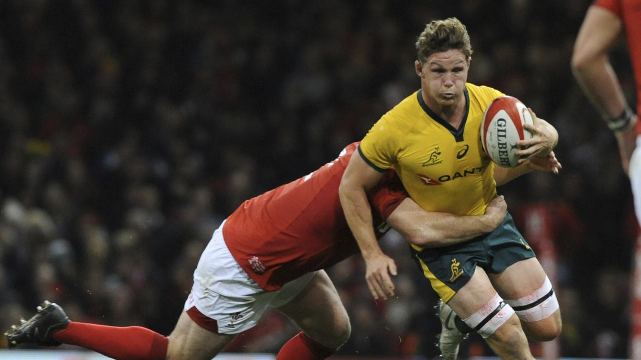 Australia's Michael Hooper is tackled by a Welsh defender at the Principality Stadium.
