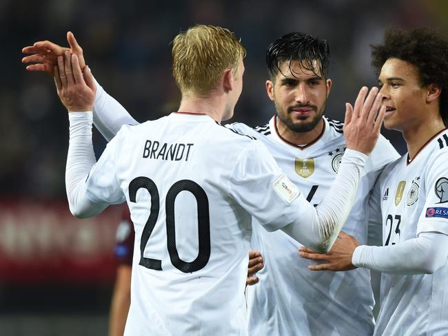 Julian Brandt, Emre Can and Leroy Sane celebrate after the fifth goal. / AFP PHOTO / Christof STACHE