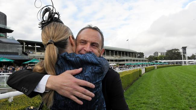 Trainer Chris Waller hugs wife Stephanie after Kolding won the Epsom. Pic: AAP