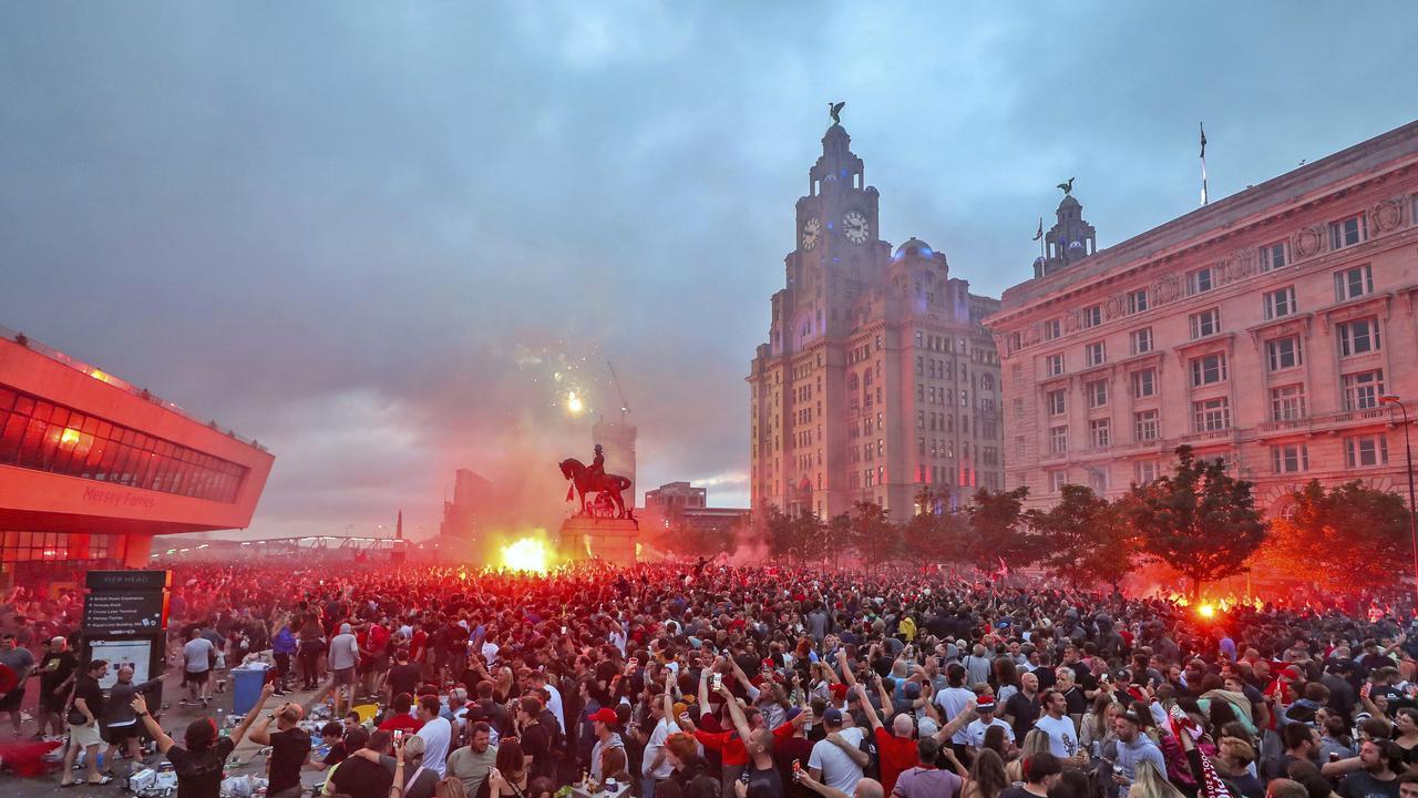 Liverpool fans let off flares outside. (Peter Byrne/PA via AP)