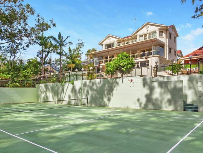 The home backs onto bushland and features a tennis court