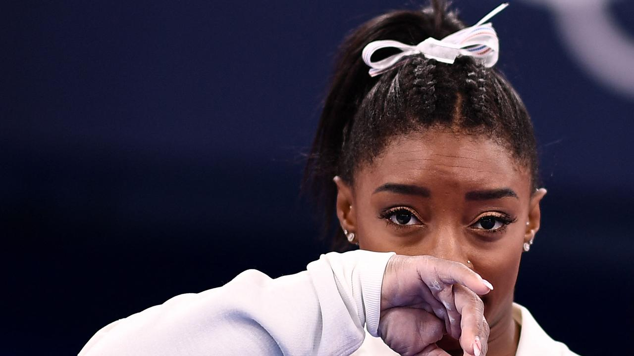 TOPSHOT - USA's Simone Biles gestures during the artistic gymnastics women's team final during the Tokyo 2020 Olympic Games at the Ariake Gymnastics Centre in Tokyo on July 27, 2021. (Photo by Loic VENANCE / AFP)