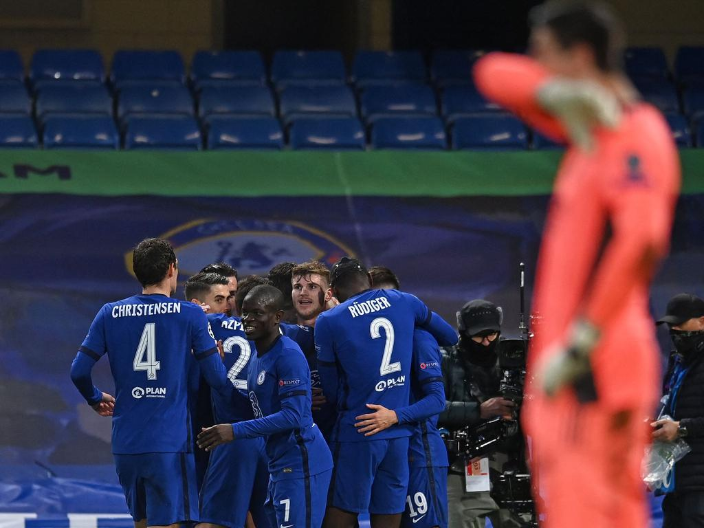 Chelsea's German striker Timo Werner is mobbed by teammates after scoring the opening goal during the UEFA Champions League second leg semi-final football match between Chelsea and Real Madrid at Stamford Bridge in London on May 5, 2021. (Photo by Glyn KIRK / AFP)