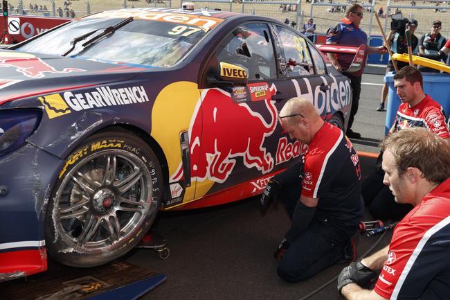 Van Gisbergen's car is unloaded back at the Red Bull garage.