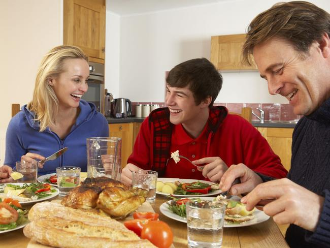 Teenage family eating together.