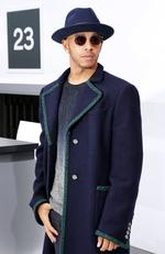 Lewis Hamilton poses before the Chanel Spring/Summer 2016 women's ready-to-wear show during Paris Fashion Week. Picture: AFP