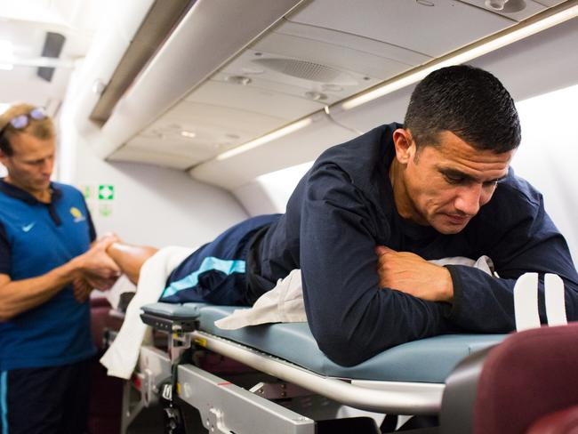 Tim Cahill recovers with a mid-flight massage. Picture: Socceroos/Football Federation of Australia