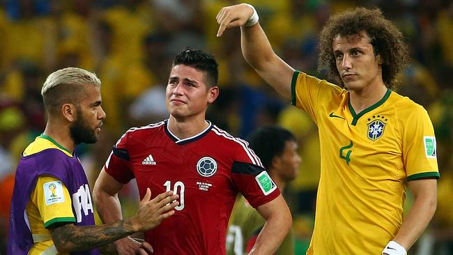 FILE - JULY 22; 2014: Real Madrid have signed World Cup Golden Boot winner James Rodriguez from French club Monaco. FORTALEZA, BRAZIL - JULY 04: Dani Alves (L) and David Luiz of Brazil console James Rodriguez of Colombia after Brazil's 2-1 win during the 2014 FIFA World Cup Brazil Quarter Final match between Brazil and Colombia at Castelao on July 4, 2014 in Fortaleza, Brazil. (Photo by Robert Cianflone/Getty Images)