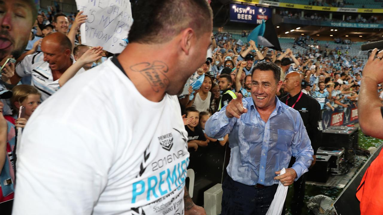 Sharks coach Shane Flanagan points at Andrew Fifita after he poured water over him after the 2016 NRL Grand Final. Picture: Brett Costello