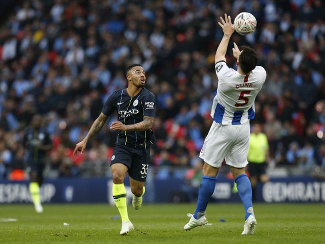 Manchester City's Brazilian striker Gabriel Jesus (L) vies with Brighton's English defender Lewis Dunk. Picture: Ian Kington/AFP