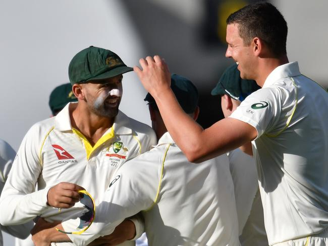 Josh Hazlewood (right) and Nathan Lyon (left) of Australia celebrate after running out James Vince.