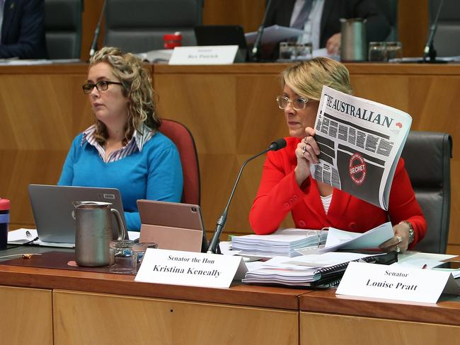 Kristina Keneally holding up the front pages of the papers as she asks questions at a Senate Estimates hearing on Legal and Constitutional Affairs at Parliament House in Canberra. Picture Kym Smith