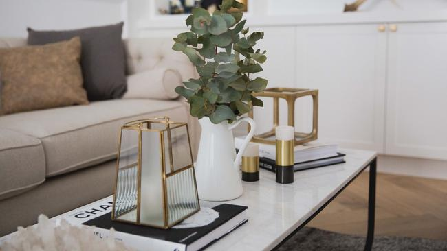 Group therapy: a beautifully arranged tableau reflects the decor theme of black, gold and white with touches of brass.