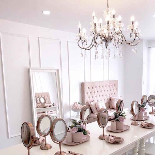 Nail stations, individual mirrors and a chandelier fill the main room of Le Petite.