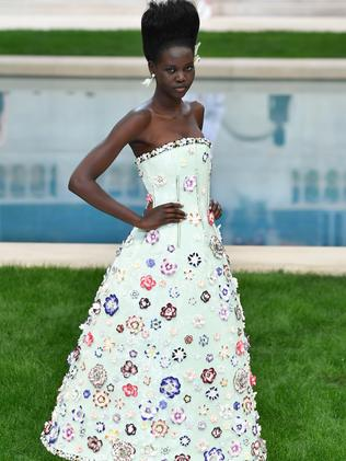 Adut Akech on the runway during Paris Fashion Week last month. Photo: Pascal Le Segretain/Getty Images