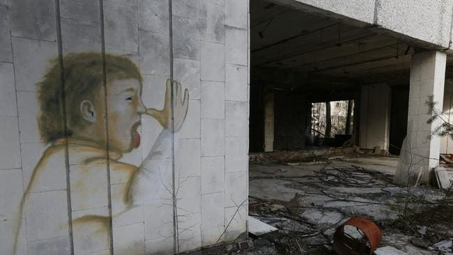 Graffiti depicts a child on the wall of the former supermarket. Picture: AP Photo/Efrem Lukatsky