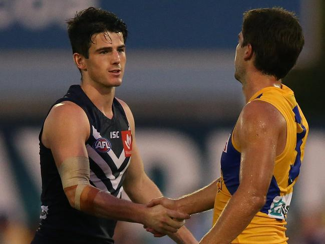 Andrew Brayshaw and Andrew Gaff make peace on the field.