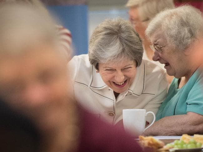 Britain's Prime Minister Theresa May speaks with locals after launching the loneliness strategy. Picture: Stefan Rousseau